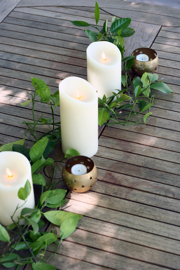 candles in between lemon leaves for a decorative table