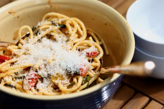 chicken pasta primavera with sun dried tomatoes, broccolini, greens, and white wine lemon sauce