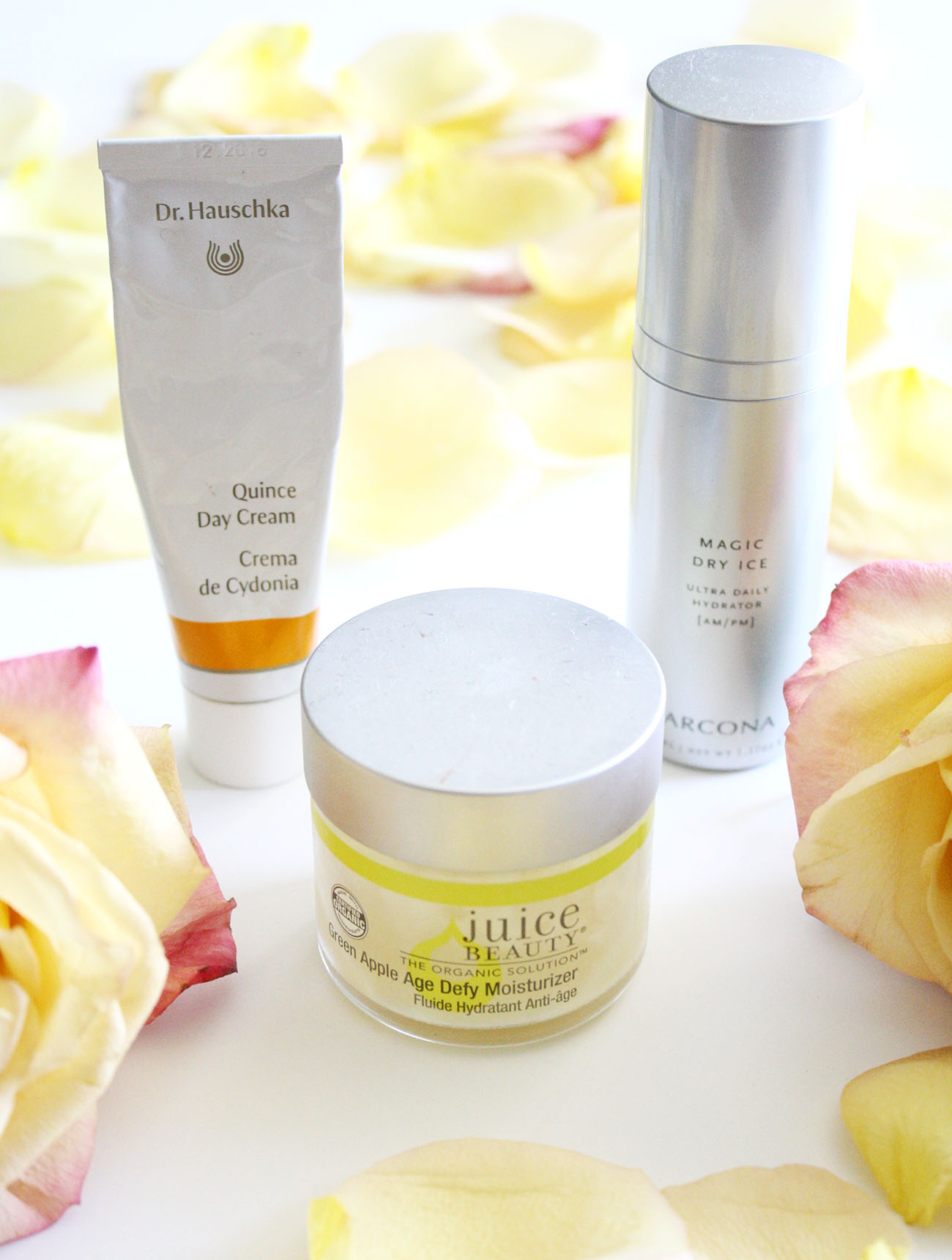review of three face moisturizers - dr hauschka quince day cream, juice beauty green apple moisturizer, arcona magic dry ice